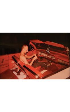 Nan Goldin, Bruce in his red car, NYC, 1981