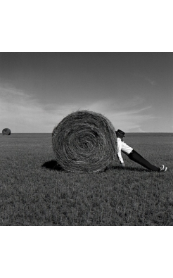 Rodney Smith, Man Leaning Against Hay Bale, Alberta, Canada, 2004