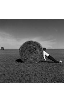 Rodney Smith, Man Leaning Against Hay Bale, Alberta, Canada, 2004