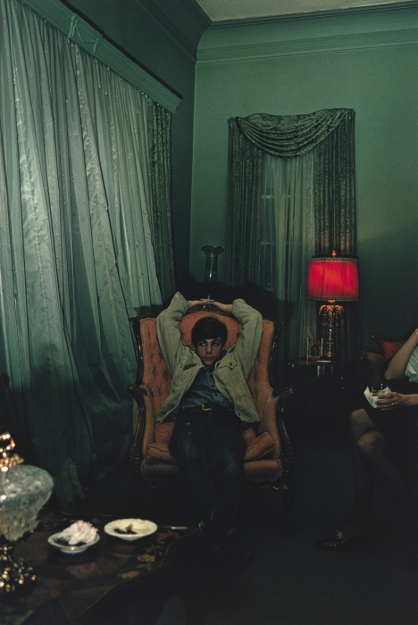 William Eggleston, Sumner, Mississippi (young man in chair), 1972