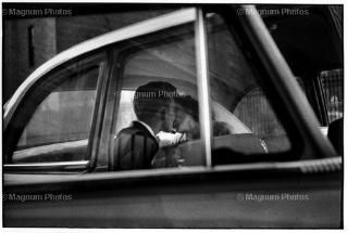 Elliott Erwitt, New York, Couple Kissing in Back of Car