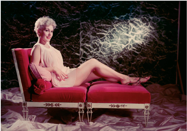 Ormond Gigli, Woman in Pink on Red Recliner